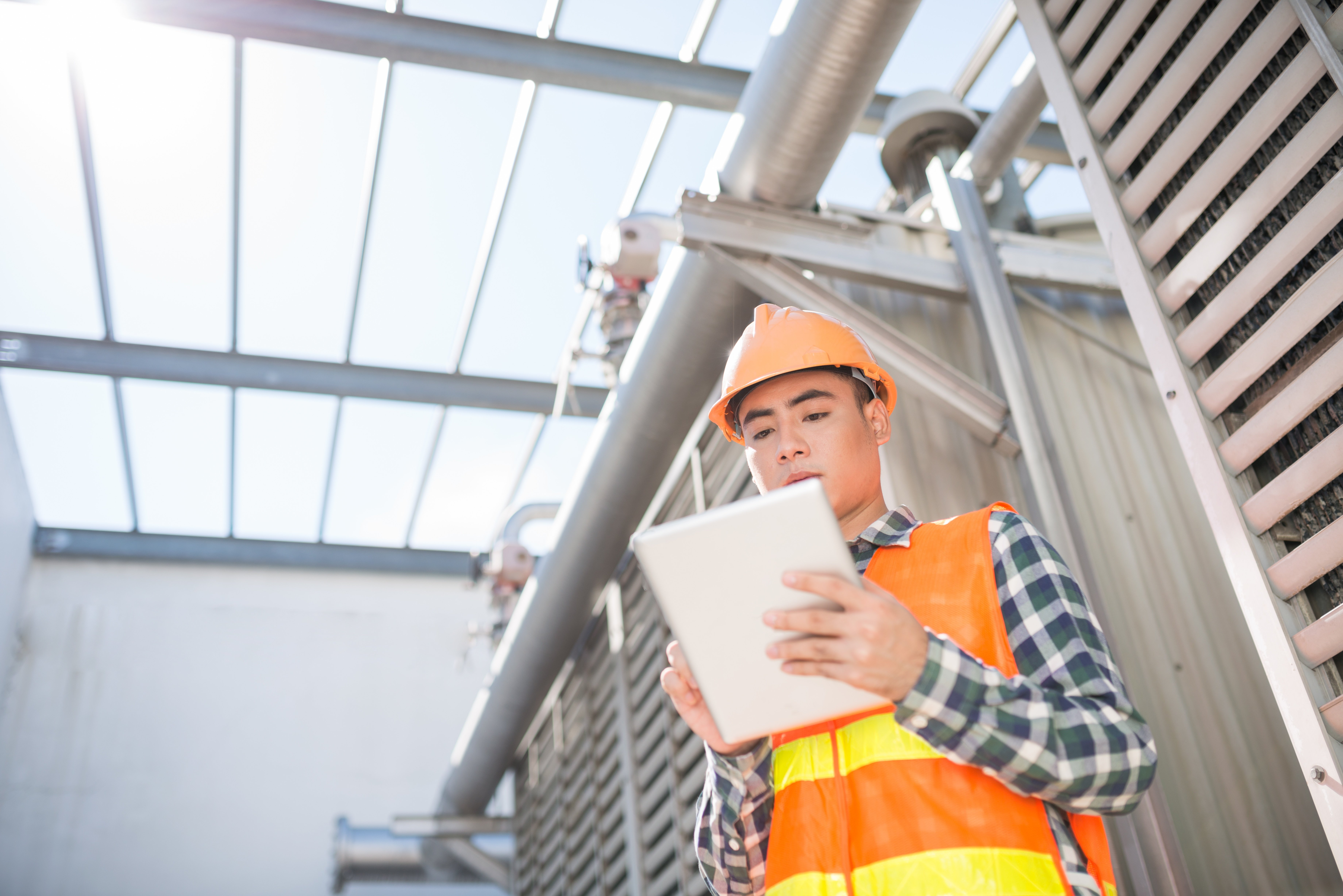 male construction worker completing a mobile form on a tablet