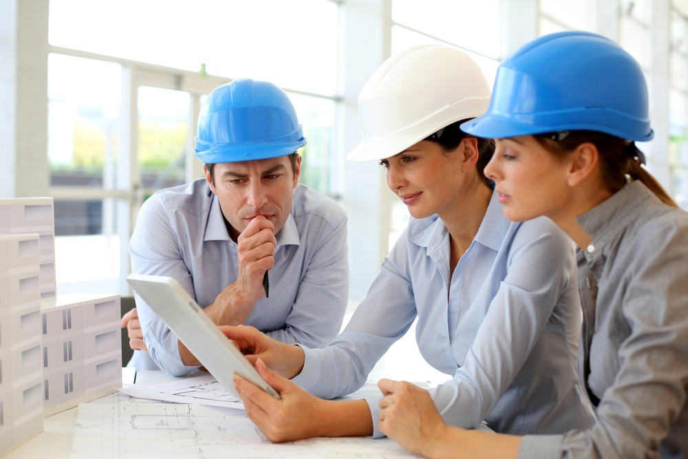 Architects working in office on construction project.jpeg