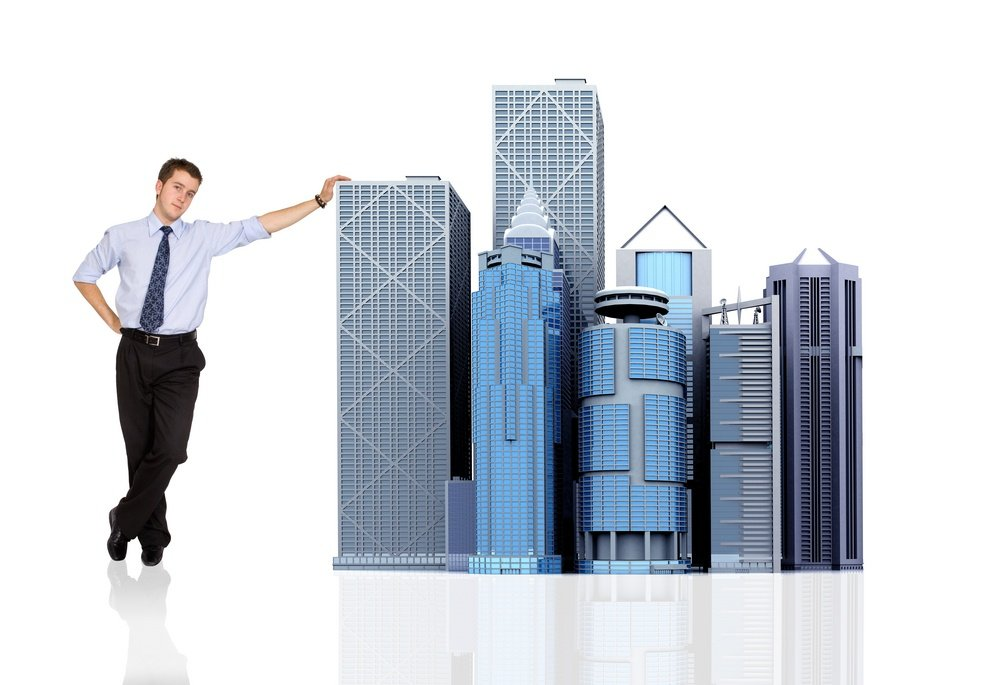 business man and his big corporation - buildings made in 3d - over white.jpeg