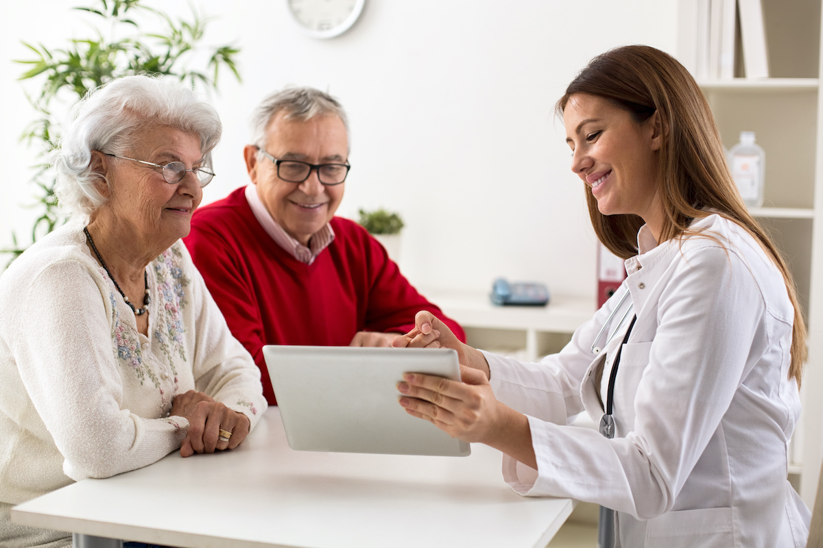 doctor and patients doing digital satisfaction survey on tablet