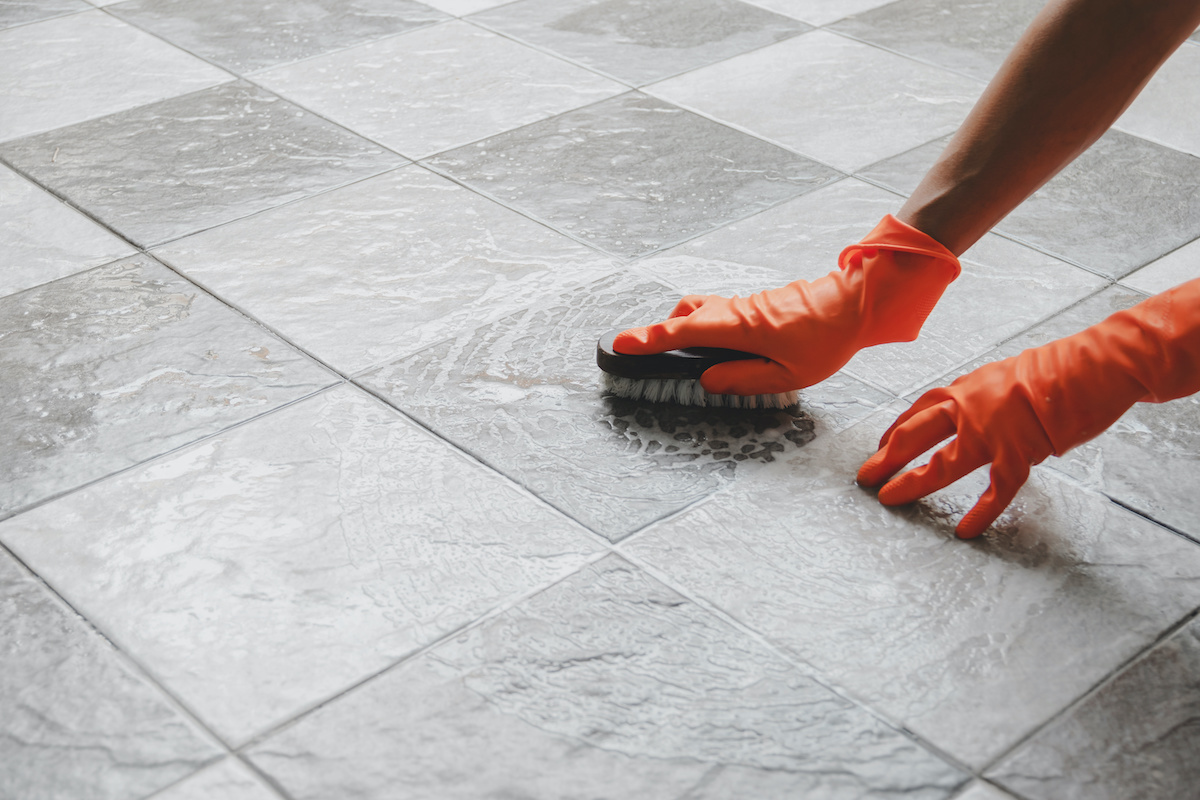 cleaning up floor for post-construction cleaning checklist
